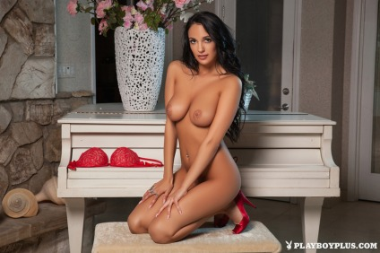 Busty brunette unveils big tits under red lingerie